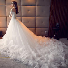 一字肩婚纱大拖尾韩式时尚羽毛V领2017年春季新款长拖尾婚纱