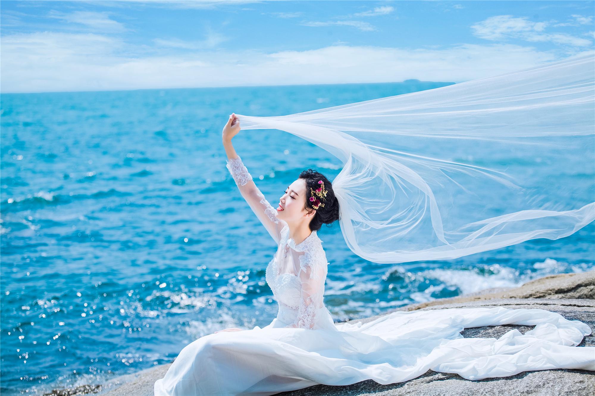 海滩礁石唯美海景婚纱照客片