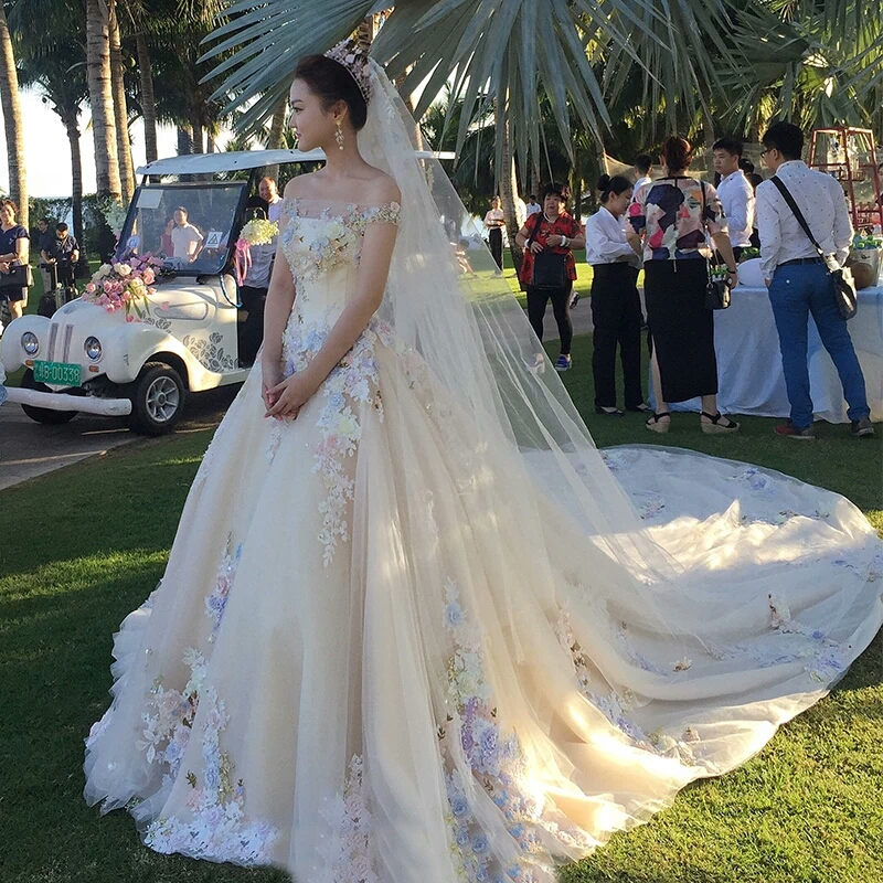 婚纱礼服2017新款新娘一字肩齐地公主梦幻森系彩色花朵长拖尾