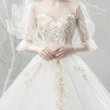 轻婚纱2018新款韩版公主梦幻拖尾显瘦森系旅拍新娘婚纱简约